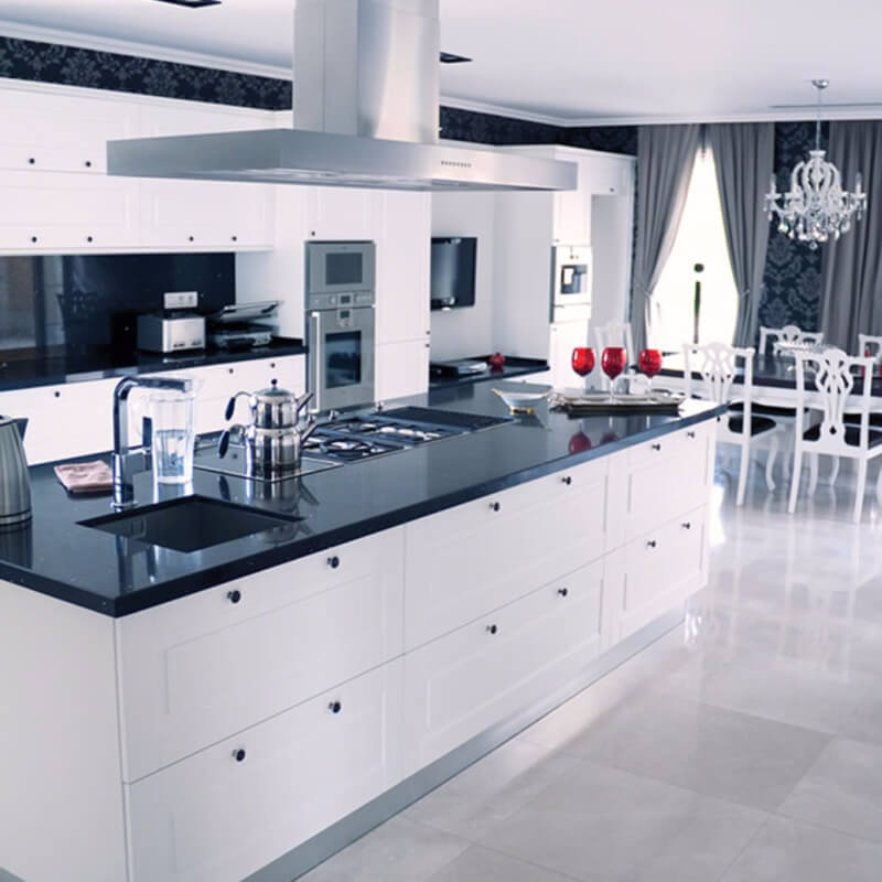 Black And Gray Quartz Countertops In Bright Perky Kitchen