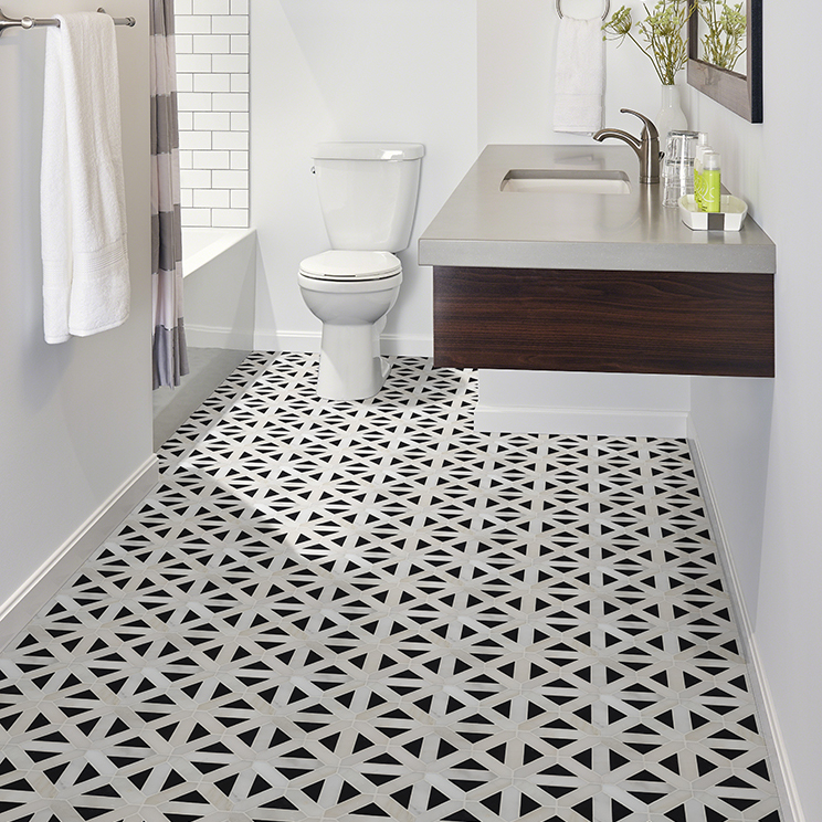 Black and white encaustic tile on a bathroom floor