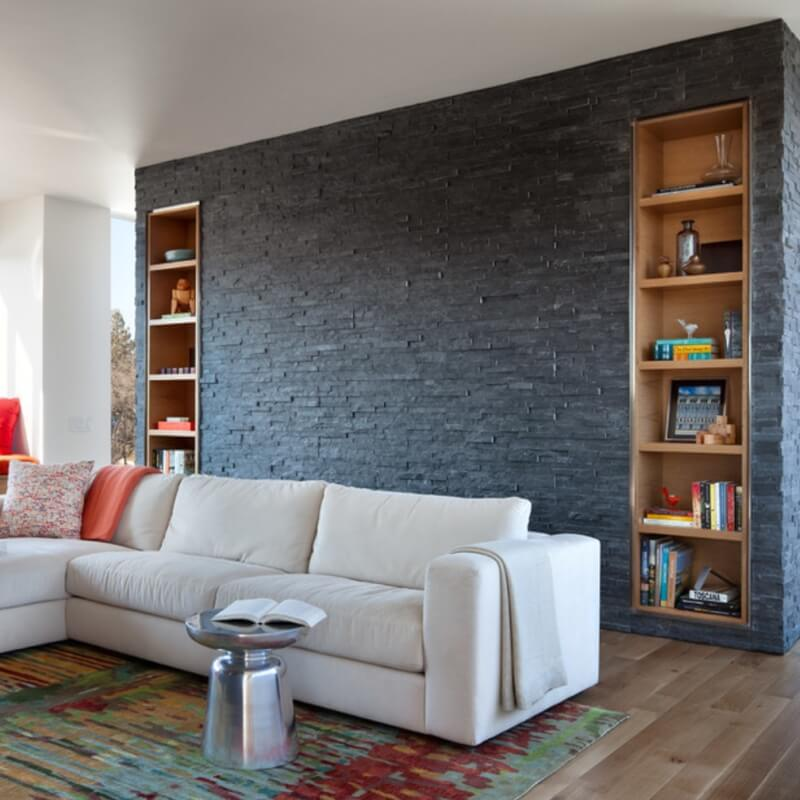 modern living room with stacked stone feature wall