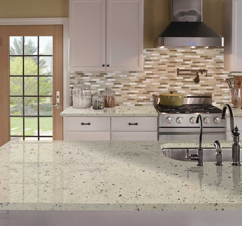 elegant neutral colored kitchen with white granite countertop