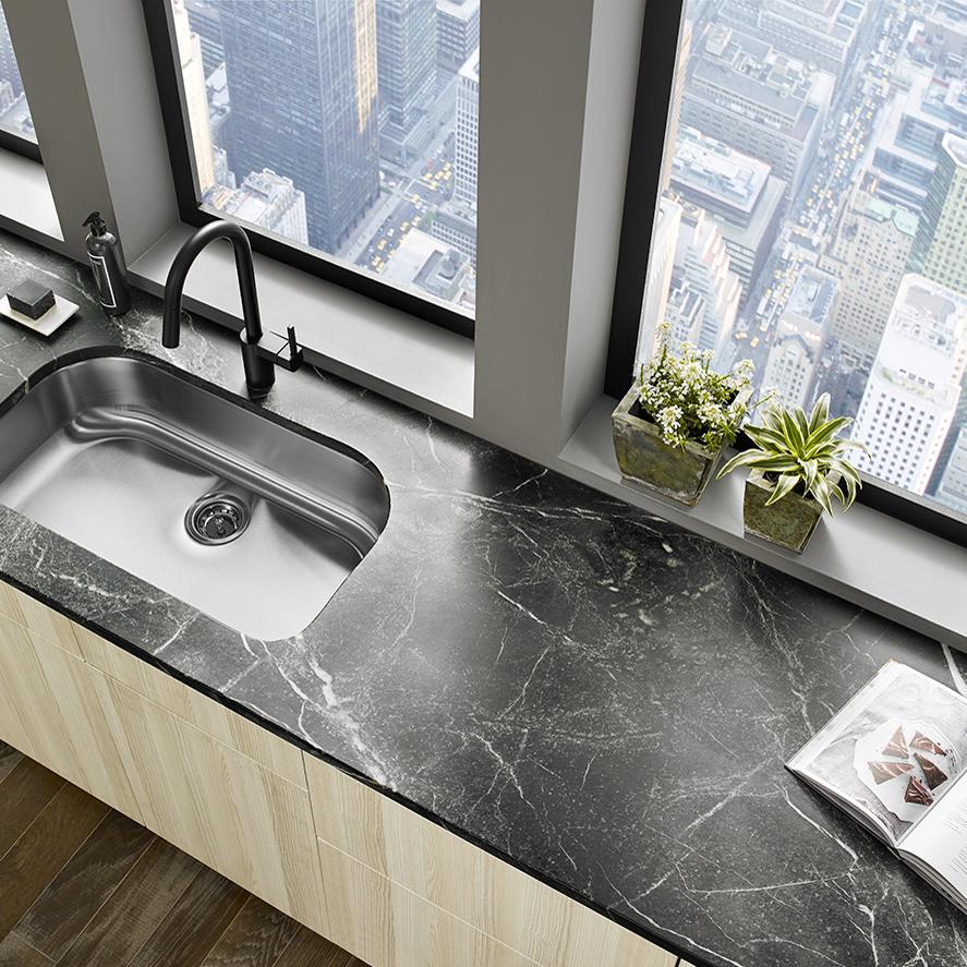 Black soapstone countertop in an urban kitchen