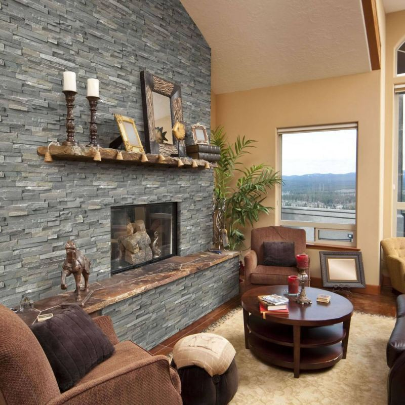 natural setting family room with stacked stone fireplace wall