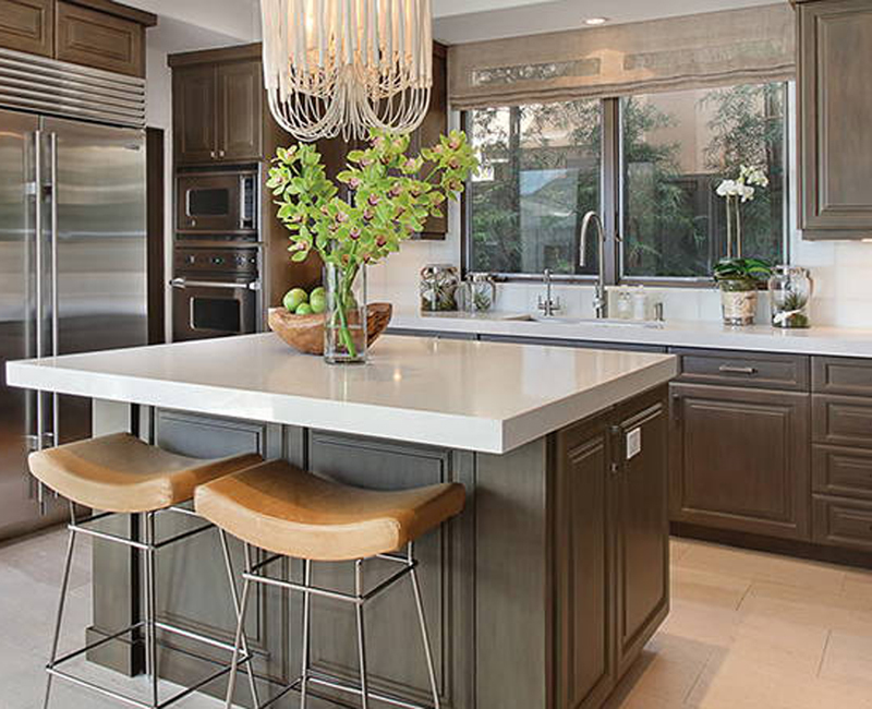 neutral tones in kitchen with white quartz countertop