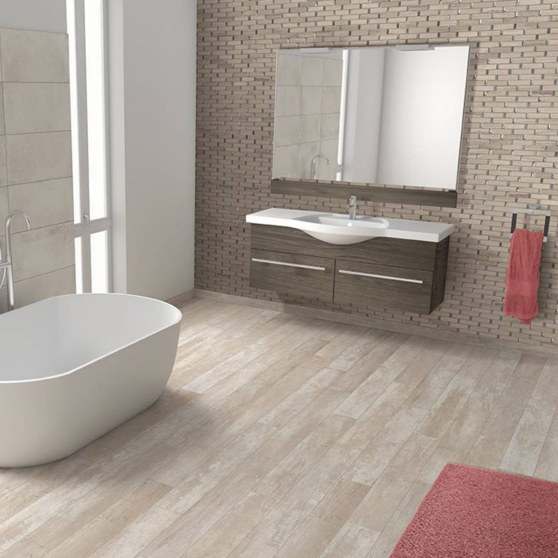 Three dimensional wall tile with wood look plank flooring in bathroom