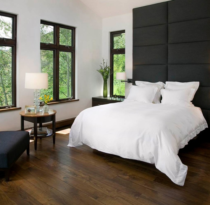 modern minimal bedroom with dark wood lvt flooring