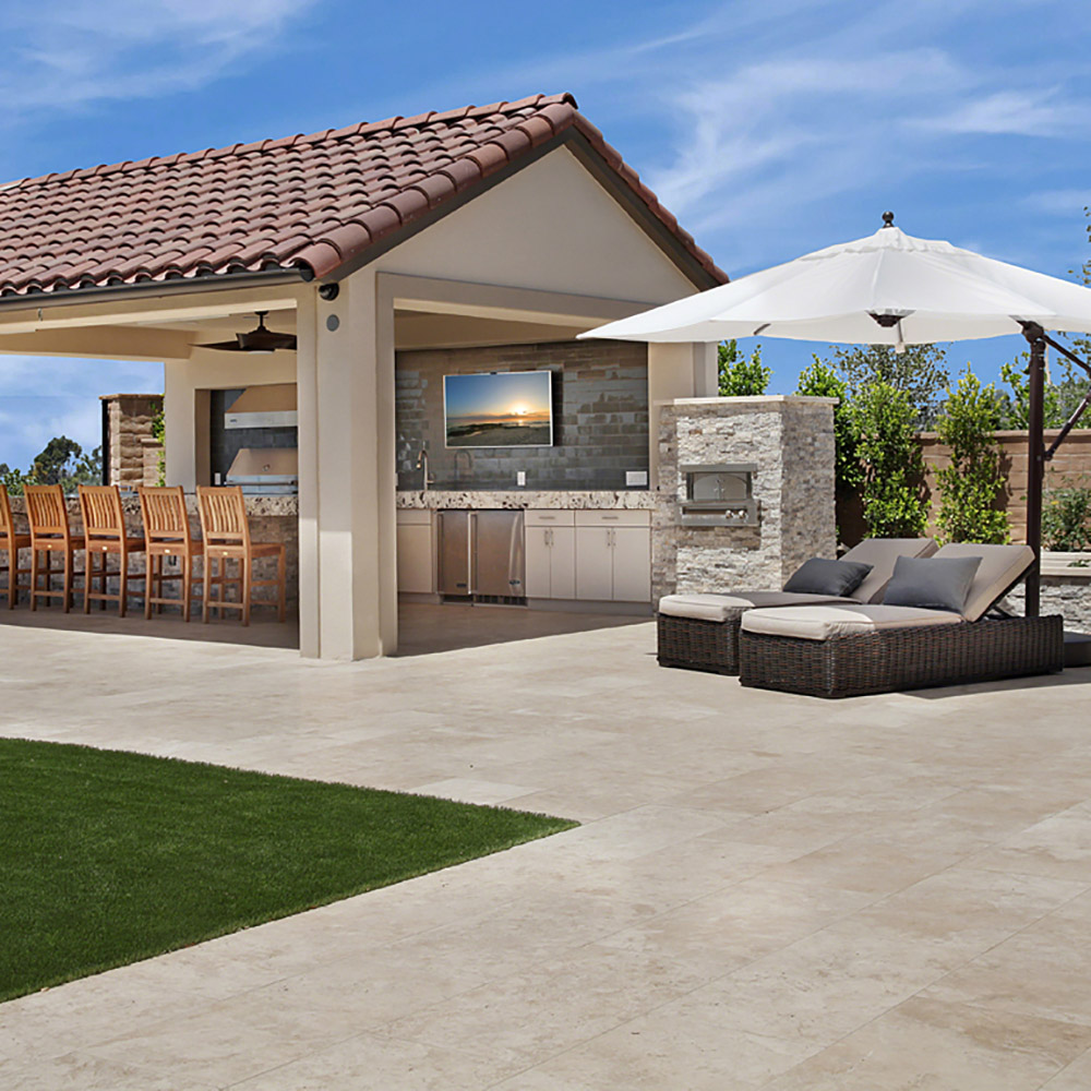 outdoor living space with glass subway tile and granite countertops