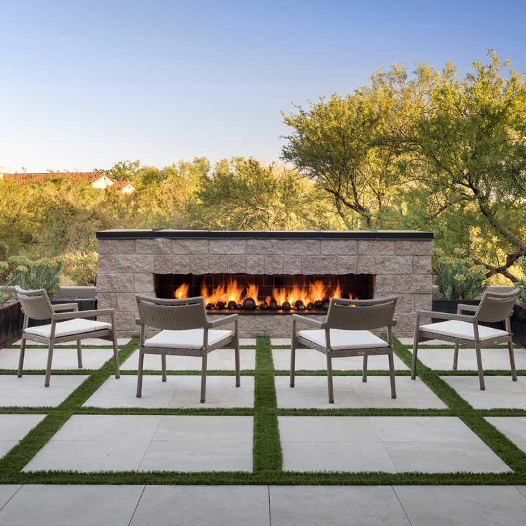 stunning outdoor fireplace with porcelain paver flooring