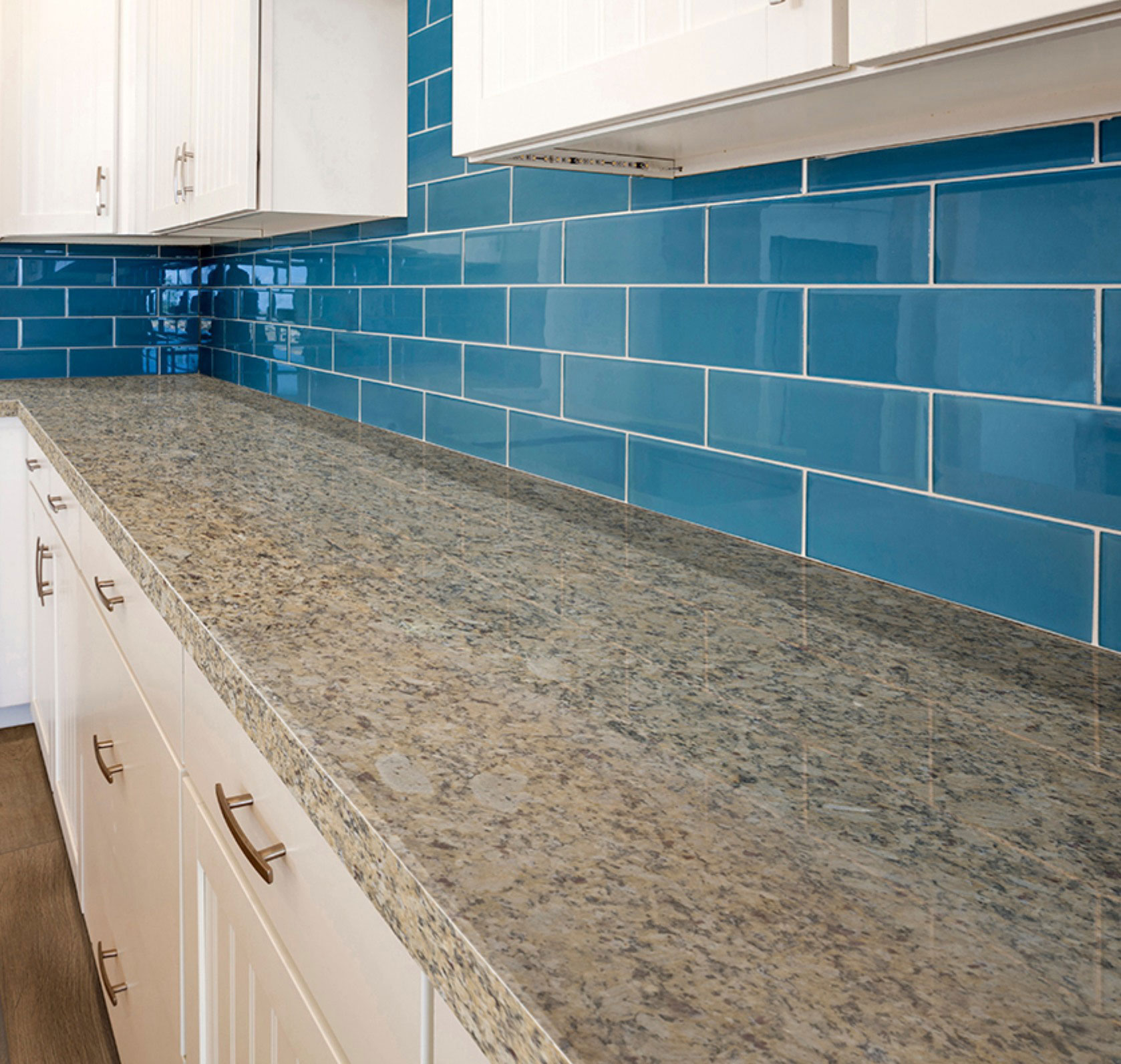golden granite kitchen with blue tile