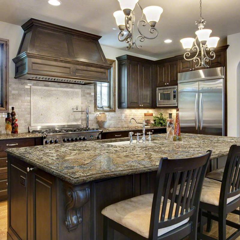 gold granite countertop kitchen with dark cabinets