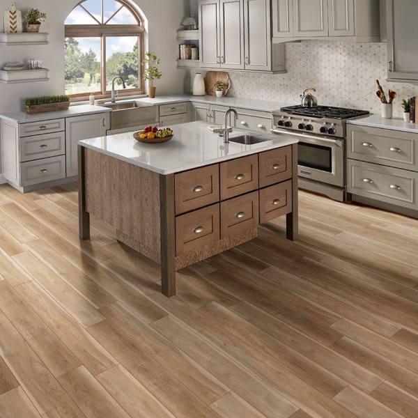 light wood vinyl plank flooring in kitchen