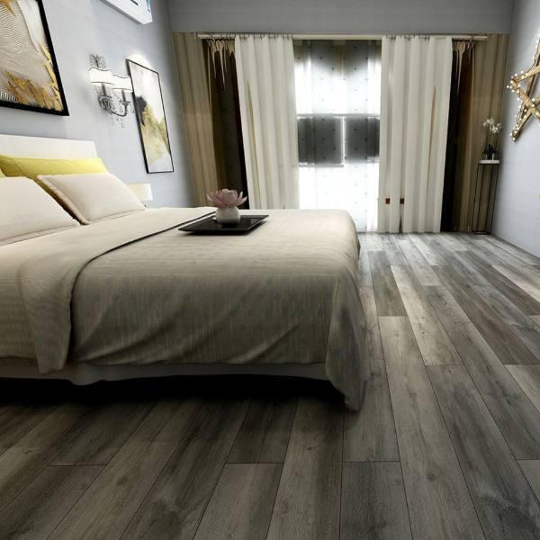 gray vinyl plank flooring in bedroom