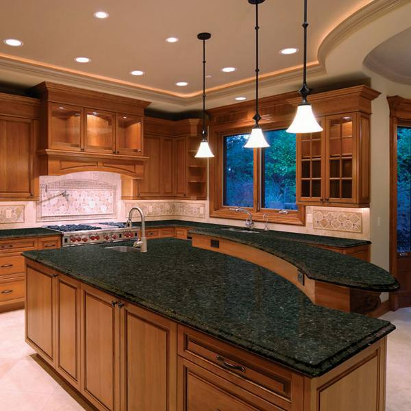 granite countertop with honey colored cabinets