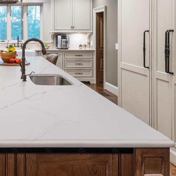 white and soft grey quartz kitchen