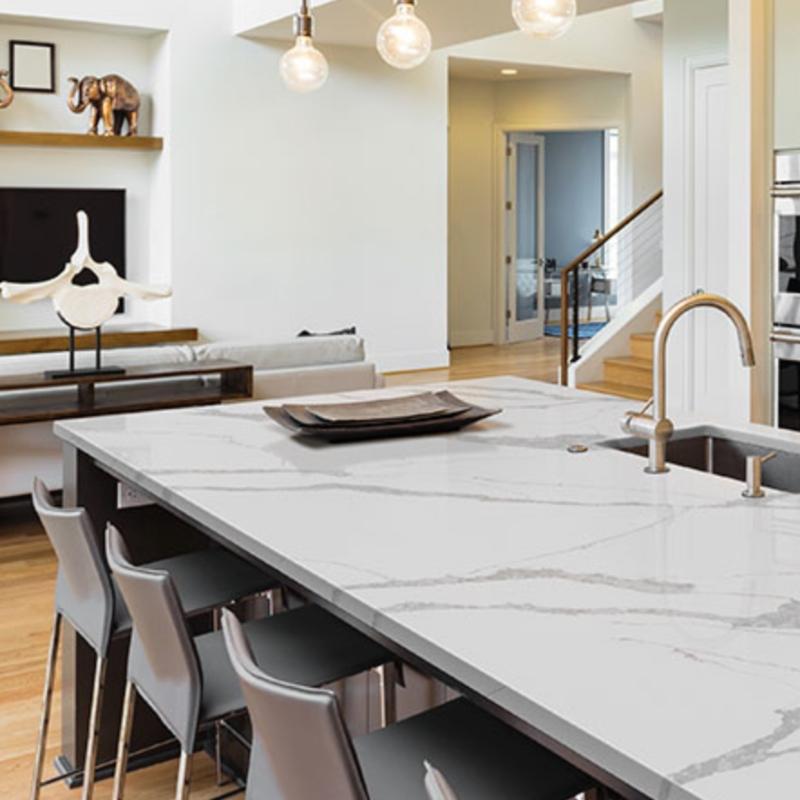 ultra clean kitchen with white quartz