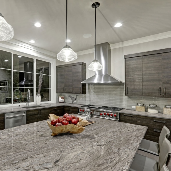 large kitchen island with silver granite counter