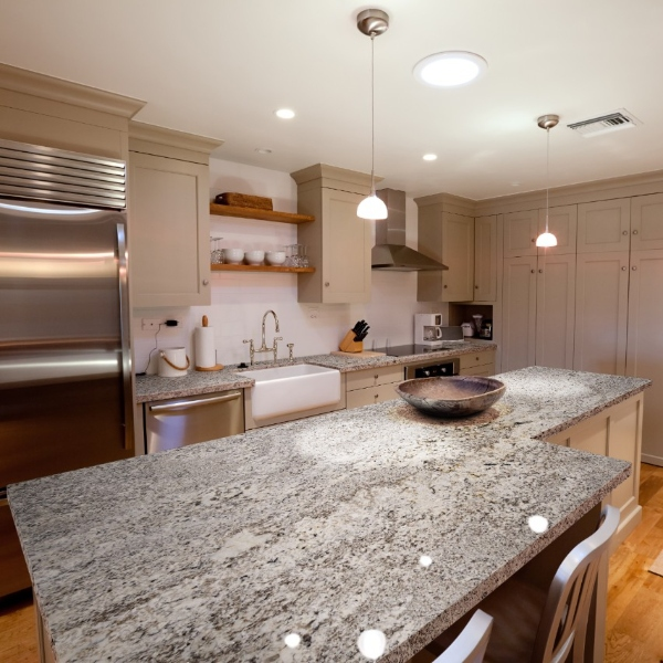 soft grey veined granite with griege cabinets