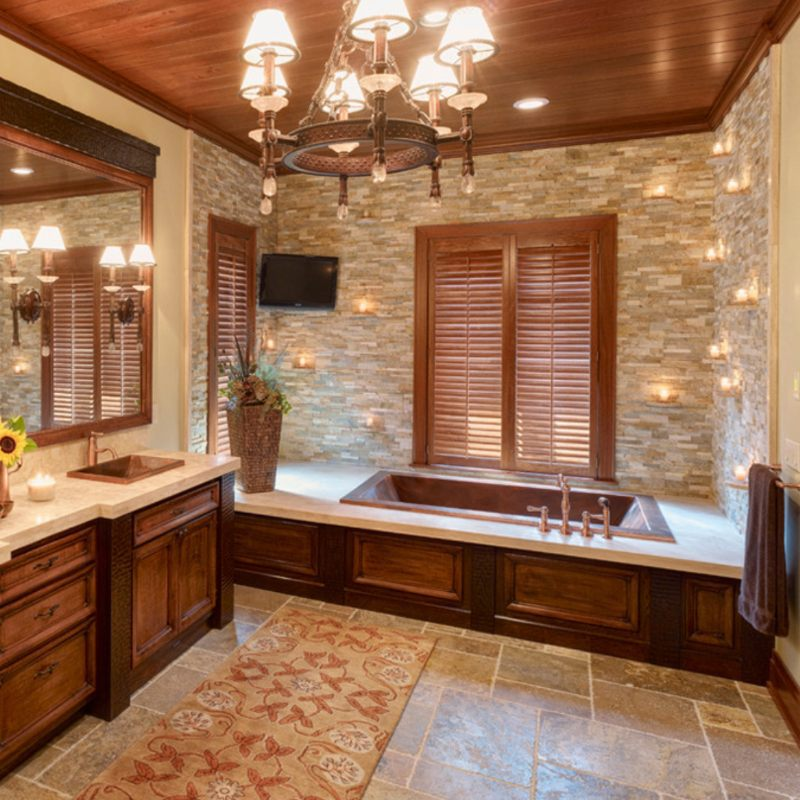 charming bathroom with stacked stone wall