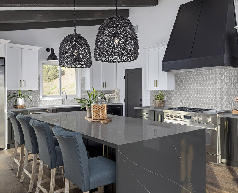 Updated kitchen with gray waterfall countertop