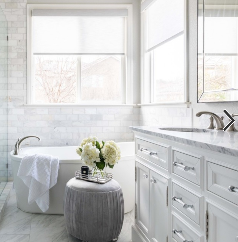 pristine whie bathroom with carrara marble