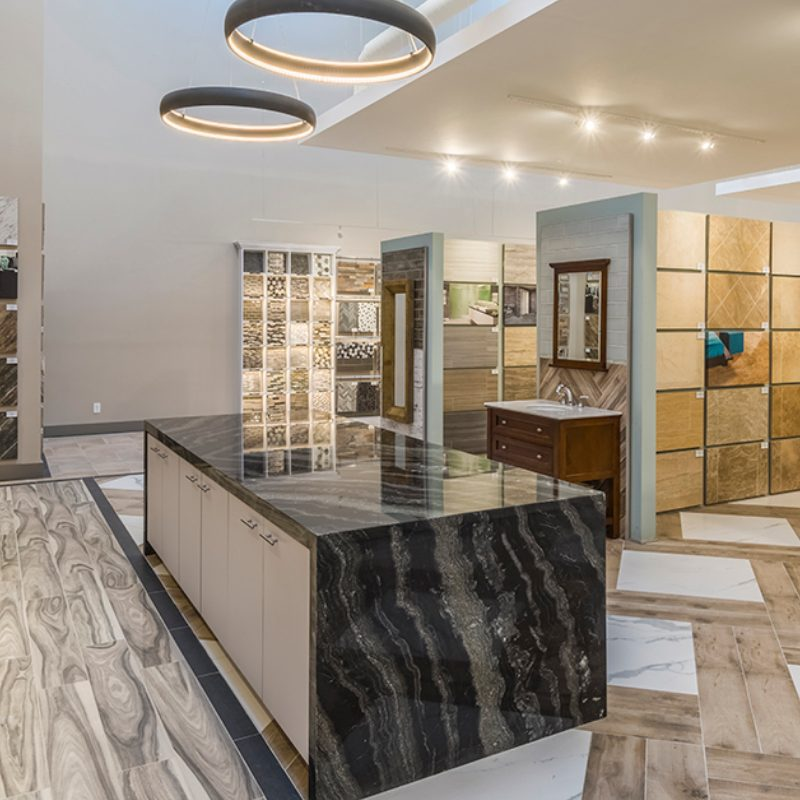 veined black countertop with waterfall