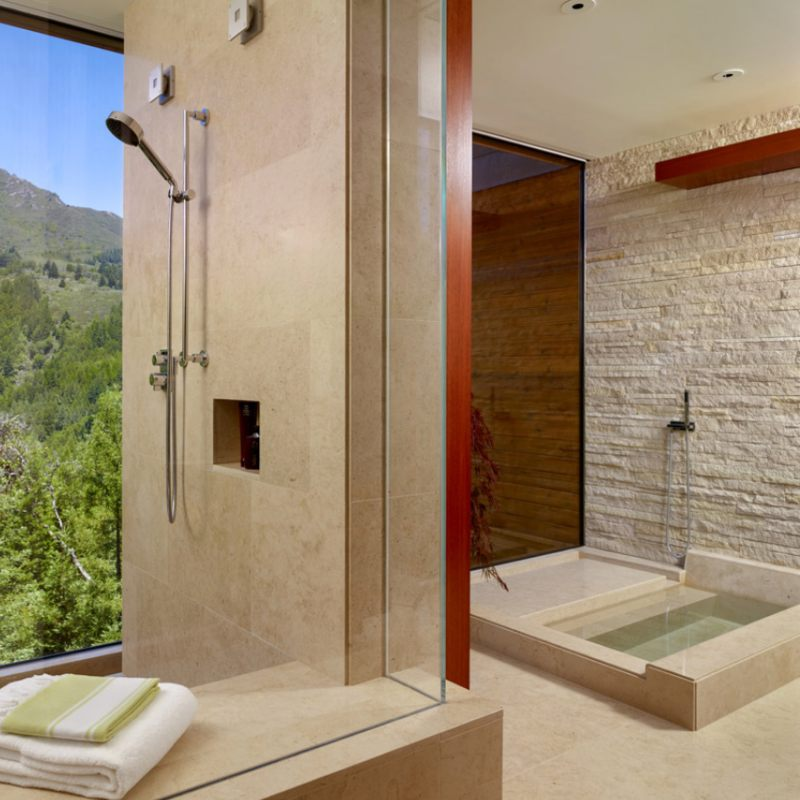 stancked stone bathroom wall cream colored and elegant