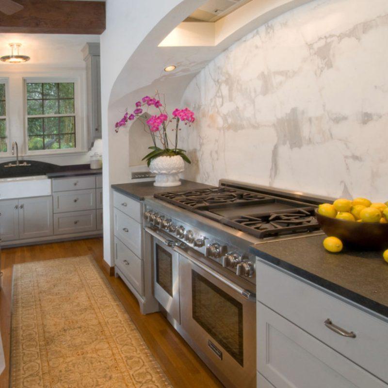 matte granite kitchen counter with marble backsplash