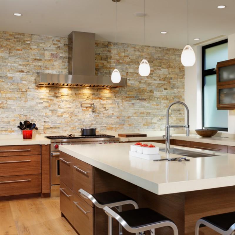 stacked stone kitchen backsplash with quartz countertop