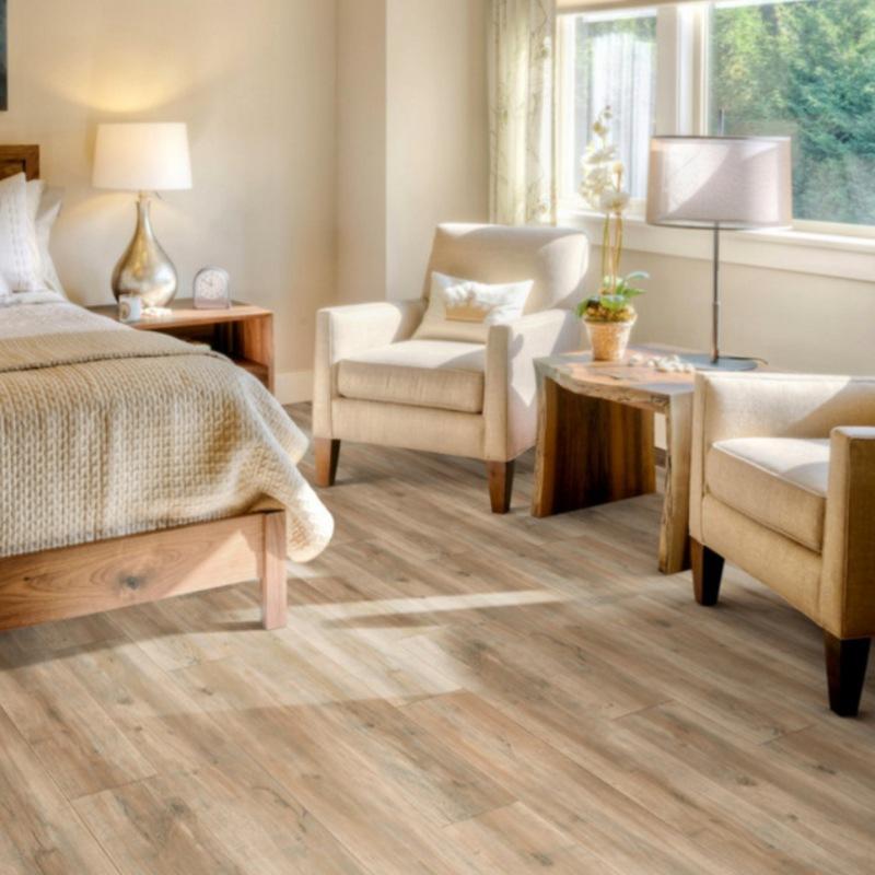 blonde luxury vinyl tile in a bright room