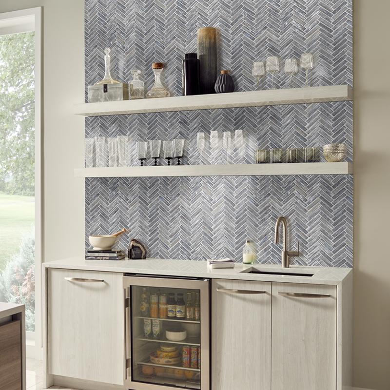 Shimmering silver herringbone backsplash tile