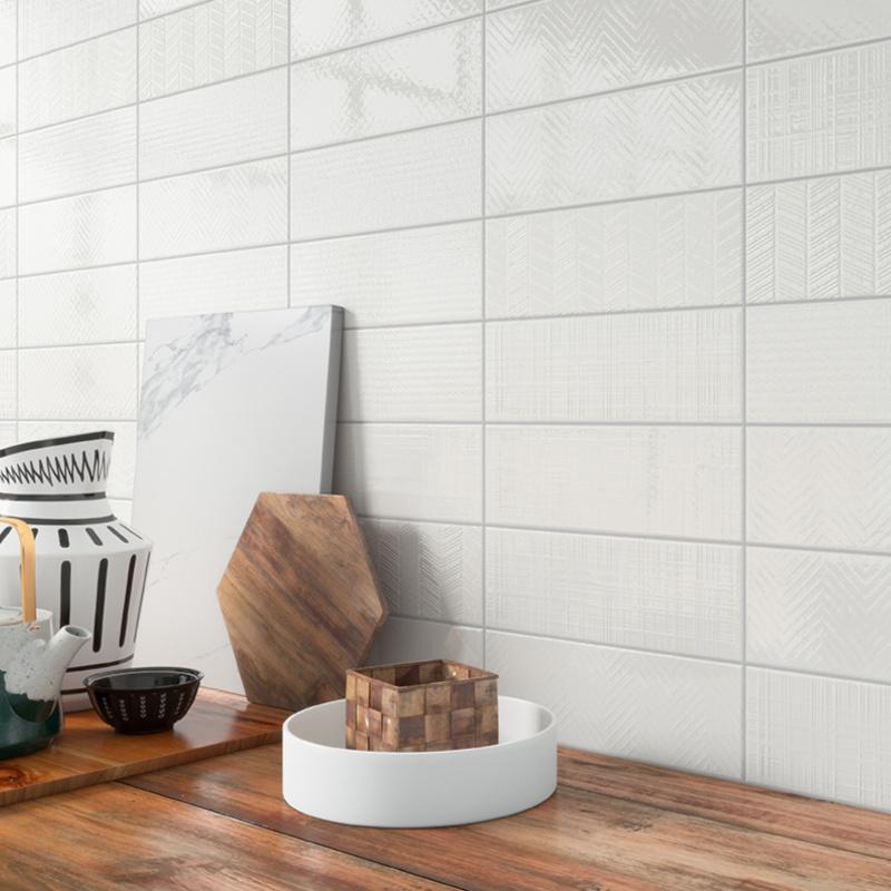 Textured subway tile kitchen backsplash