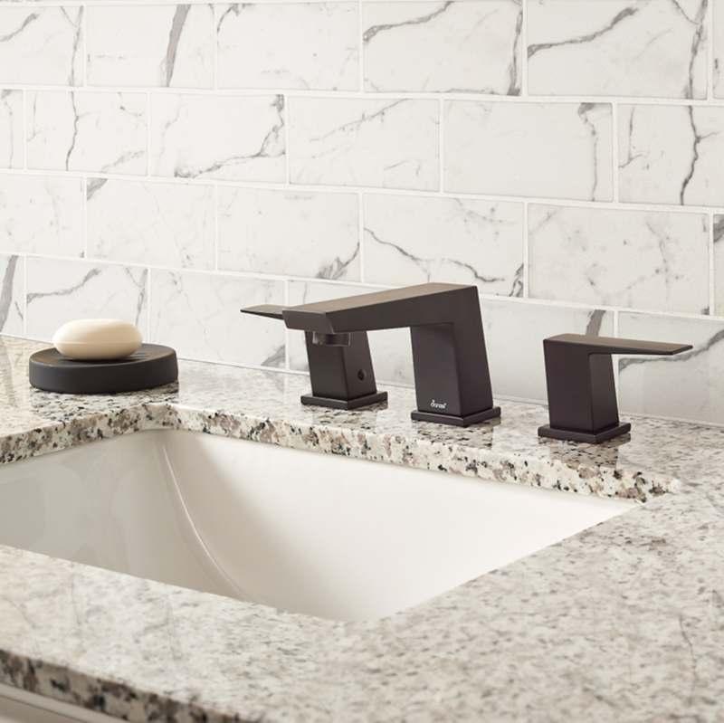 cream colored marble look glass tile backsplash bathroom