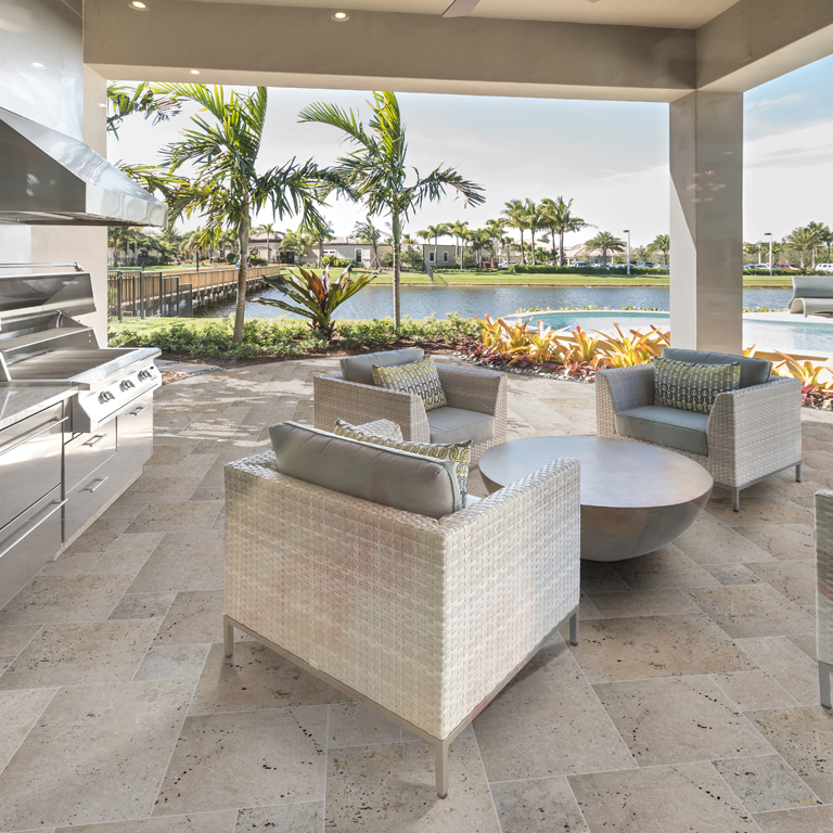 gorgeous outdoor living area with travertine flooring