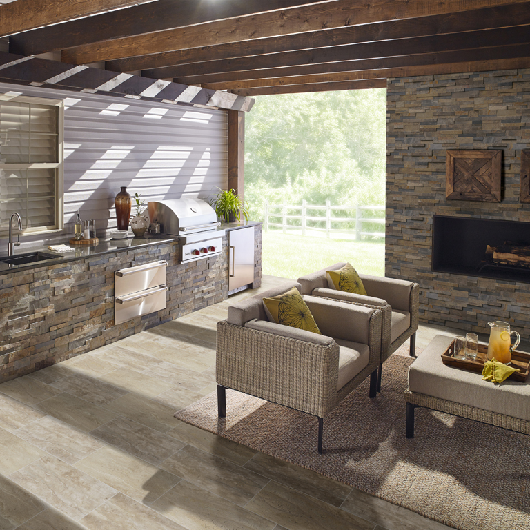 outdoor living area with stacked stone walls