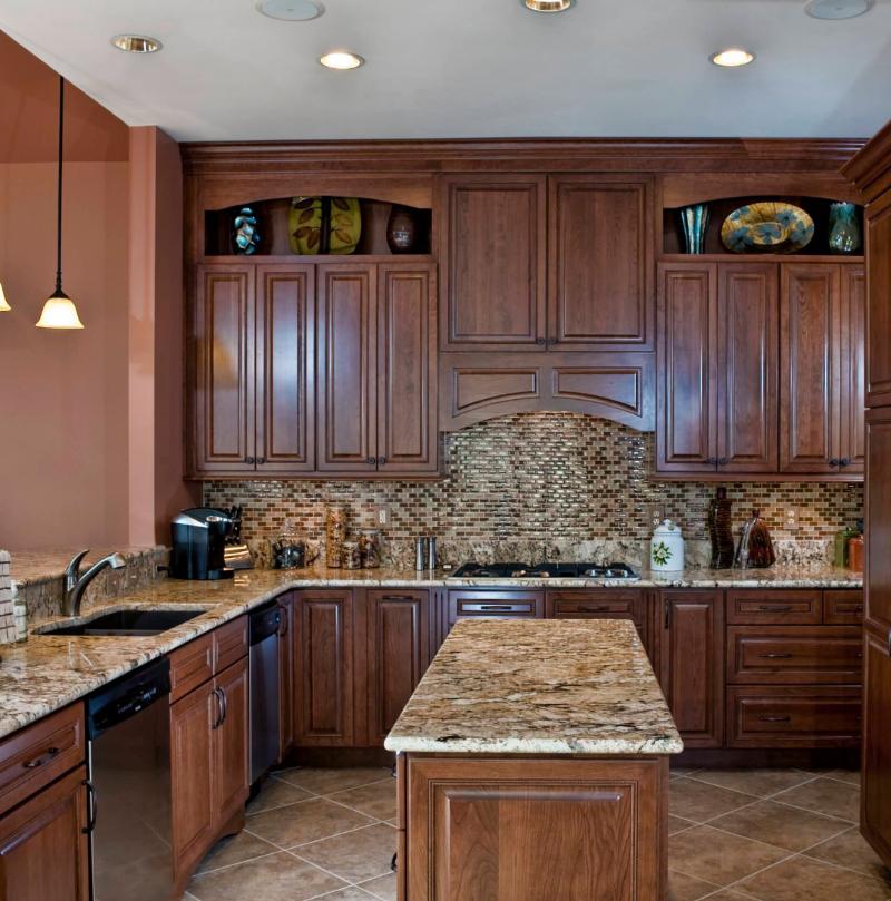 rich brown kitchen with granite countertop