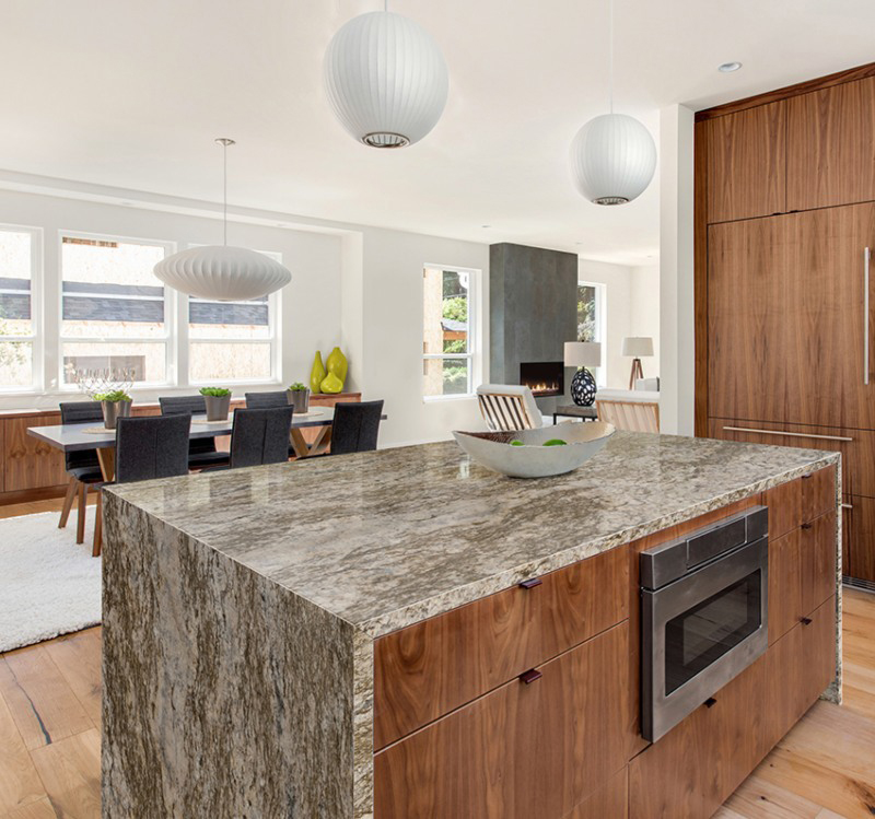 gold waterfall edge counter in bright kitchen