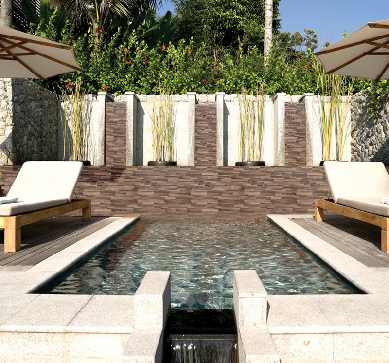 stacked stone wall panels by the pool