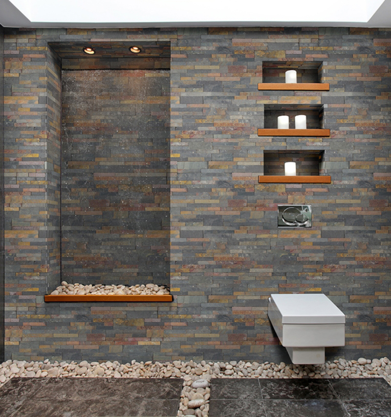 dark stacked stone panels in the shower