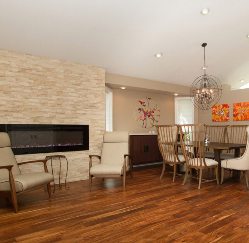 stacked stone wall in dining room