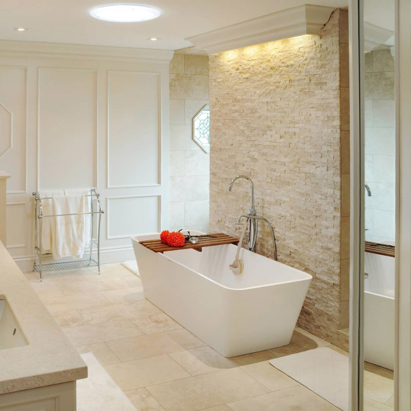 stacked stone wall in bathroom