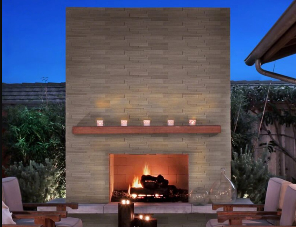 gorgeous outdoor stacked stone fireplace