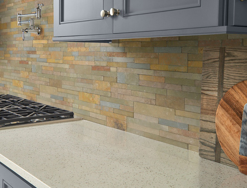 multi colored stacked stone kitchen backsplash