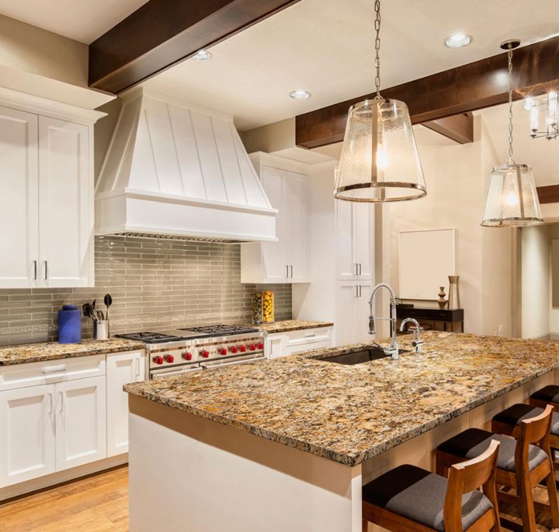 Golden Granite In White Kitchen