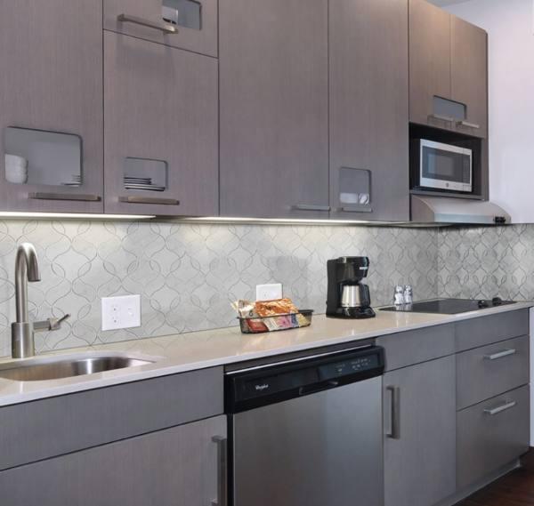 marble backsplash wavy tile in grey ktichen