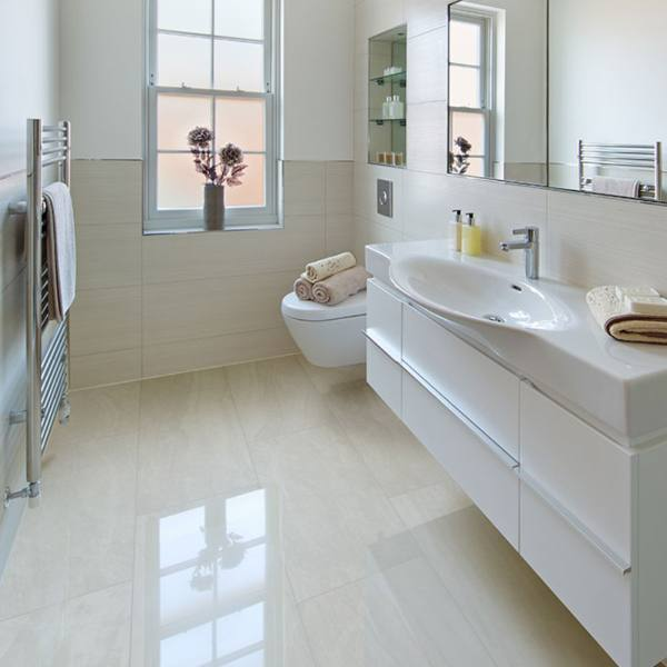 high gloss cream colored marble look tile flooring