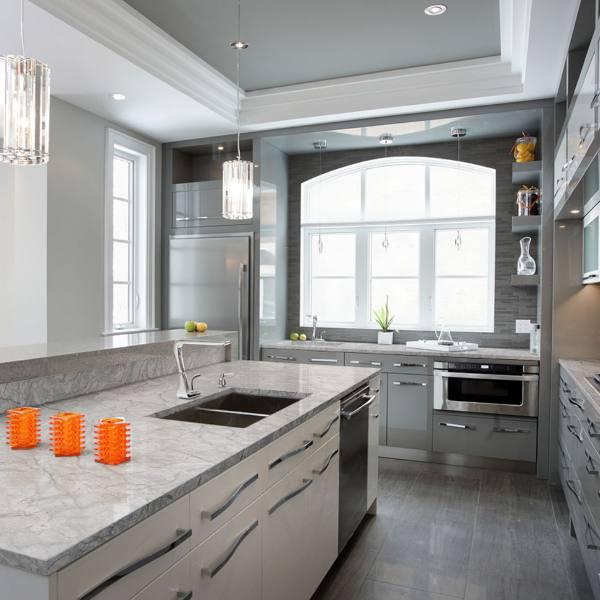 white with grey vein granite counter in monotone kitchen