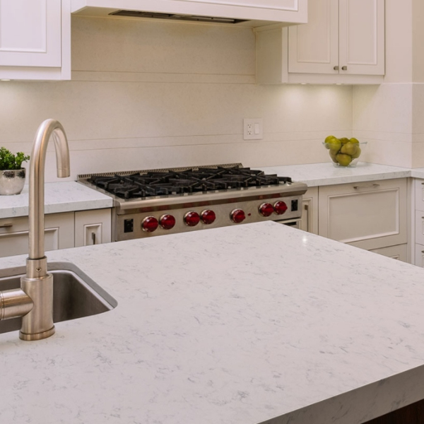 feathered veining marble look quartz in all white kitchen