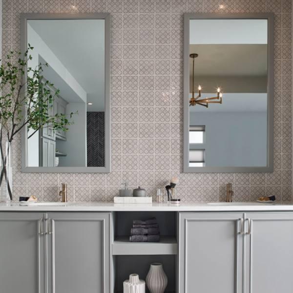 imported Spain tile backsplash in bathroom cream colored
