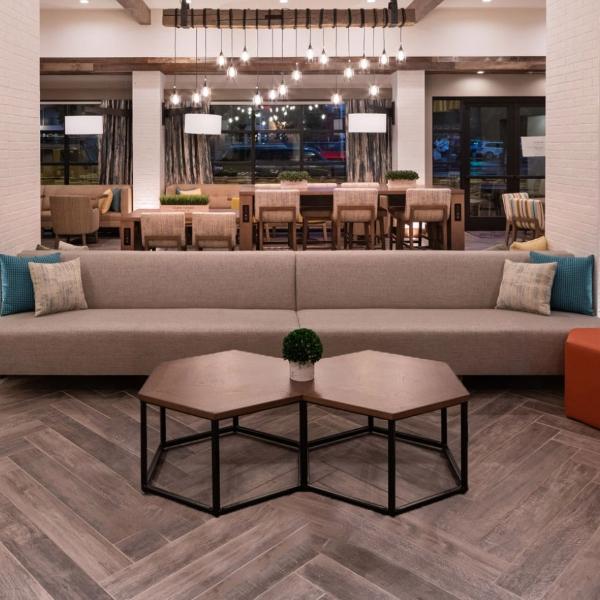 weather wood look tile flooring in hotel lobby