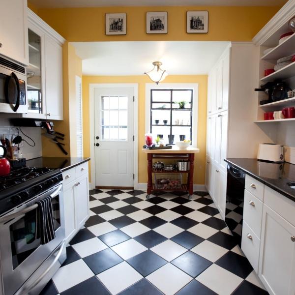 checkered retro kitchen with black and white tile flooring