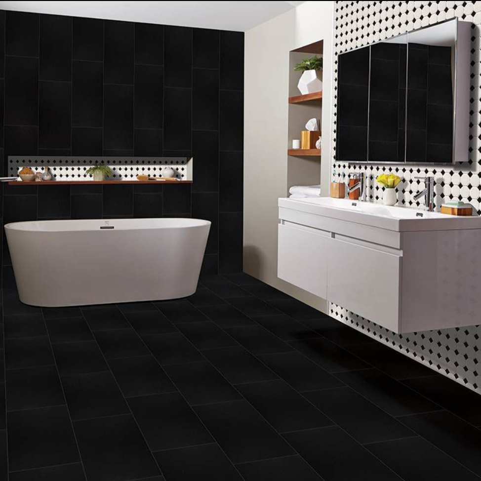 dramatic porcelain tile bathroom with black and white tile